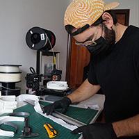 Photo of alumni making cloth mask
