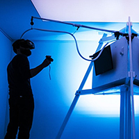Photo of man interacting with installation.
