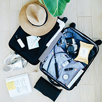 Photo of clothes in a suitcase.